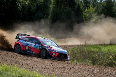 Craig Breen and Paul Nagle drifting in a corner on gravel.
