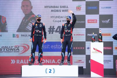 Craig Breen and Paul Nagle on the podium in the Rally Estonia.