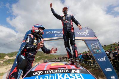 Hyundai Motorsport driver Dani Sardo on his i20 Coupe WRC celebrating.