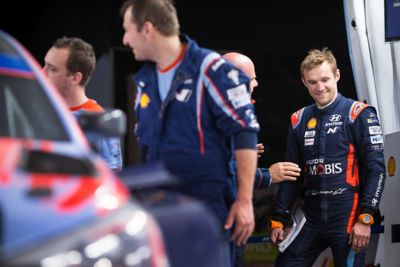 Hyundai Motorsport co-driver Martin Järveoja smiling whilst being in a chat.