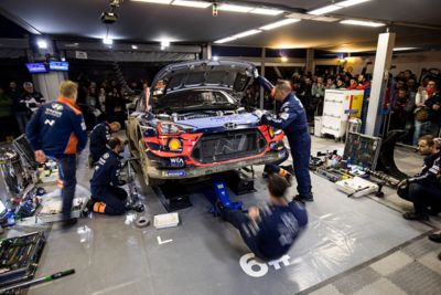 Hyundai Motorsport mechanics working a i20 Coupe WRC