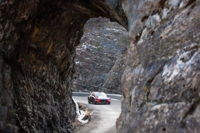 Hyundai Motorsport car viewed through rock arch