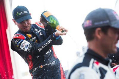 Hyundai Motorsport driver Nicolas Gilsoul spraying champagne in celebration of a victory