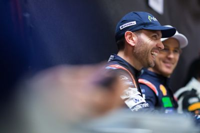Hyundai Motorsport driver Nicolas Gilsoul laughing with driver Thierry Neuville in the background