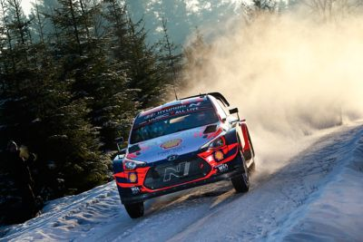 Hyundai i20 Coupe WRC driving on a snowy track