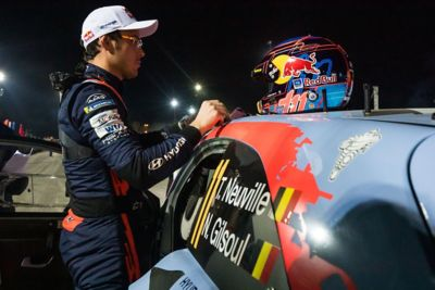 Hyundai Motorsport driver Thierry Neuville standing by his car with his helmet on the roof of the car