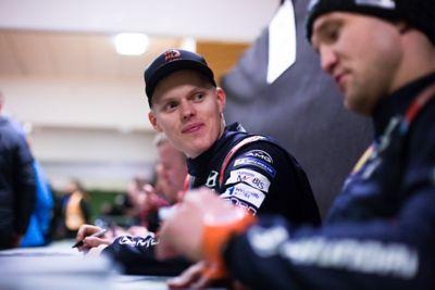 Hyundai Motorsport driver Ott Tänak and co-driver Martin Järveoja signing autographs