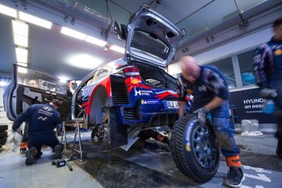 Hyundai Motorsport mechanics working on the vehicle