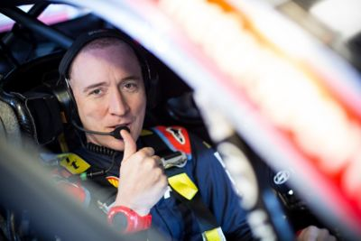 Co-Driver Paul Nagle giving his thumbs up in the Hyundai i20 Coupe WRC 2021.