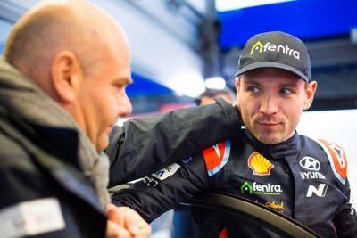 Hyundai Motorsport co-driver Nicolas Gilsoul greeting and handshaking a crew member