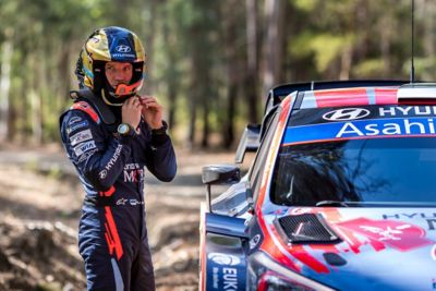 Hyundai Motorsport driver Ott Tänak wearing his helmet preparing to enter the car