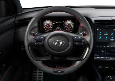 Detail of the all-new Hyundai TUCSON Hybrid N Line leather steering wheel