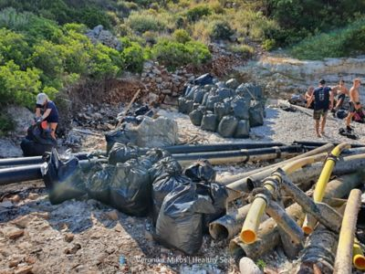 Debris salvaged by Healthy Seas volunteers, bagged up and waiting for transportin Ithaca, Greece.