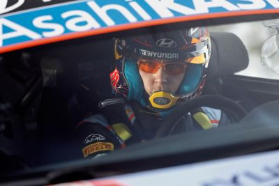 Hyundai Motorsport driver Thierry Neuville on the steering wheel of his i20 Coupe WRC.
