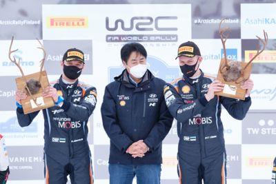 Hyundai Motorsport co-driver Martin Järveoja holding their trophy in the Rylle Arctic Finland.