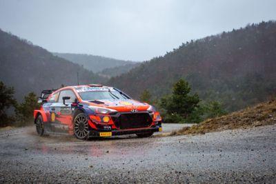Hyundai i20 Coupe WRC sliding through a corner in the Rallye Monte Carlo.