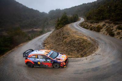 Hyundai i20 Coupe WRC cutting a corner in Rally Monte Carlo.