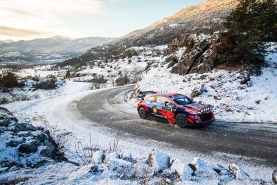 The Hyundai i20 Coupe WRC taking a left-hand turn.
