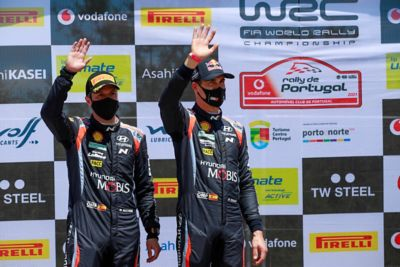 Hyundai driver Dani Sardo and his new co-driver Borja Rozada waving to the crowd at the Rally de Portugal.