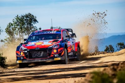 The Hyundai i20 Coupe WRC throwing up dirt.