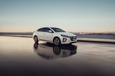 The new Hyundai IONIQ Plug-in Hybrid shown from the front featuring the new full LED headlights.