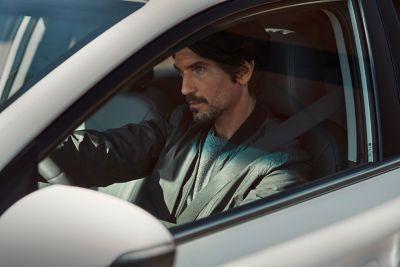 Picture of a man sitting inside thenew Hyundai IONIQ Hybrid.