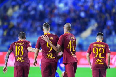 Photo of a group of Roma players celebrating, with the Hyundai logo visible on their shirts.
