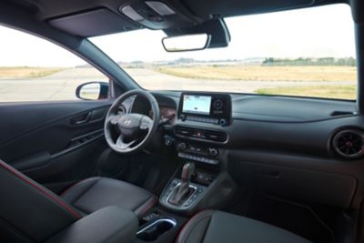 View of the Hyundai KONA N Line cockpit with red N line accents.