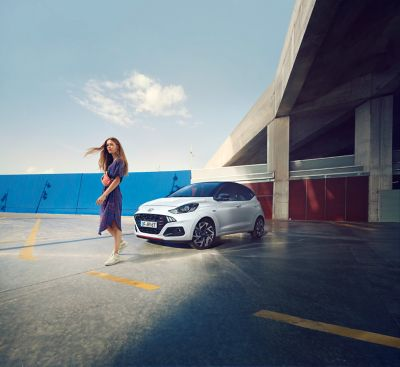 Woman in front of the Hyundai i10 N Line