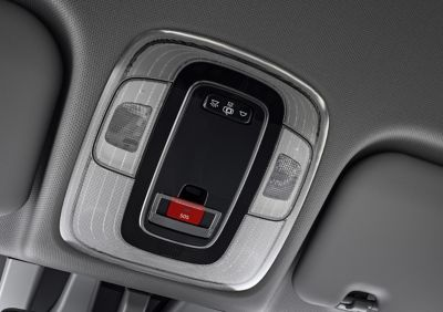 Close-up of the SOS button located in the roof of a Hyundai vehicle.