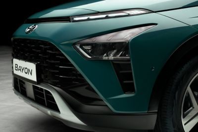 Image of the front headlight of the all-new BAYON in Mangrove Green