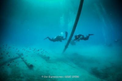 A diver from Ghost Divers recovering marine debris underwater.
