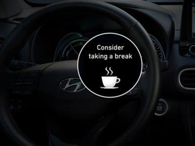 Illustrazione del sistema di rilevamento della stanchezza del conducente di Hyundai Kona Hybrid