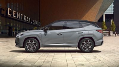 Side view of the all-new TUCSON Hybrid N Line in shadow gray.