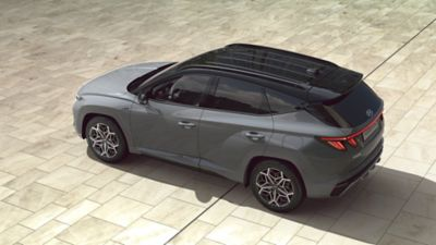 Top view of the all-new Hyundai TUCSON Hybrid N Line in shadow gray.