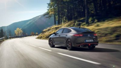 the new Hyundai i30Fastback N approaching a curve on a mountain road