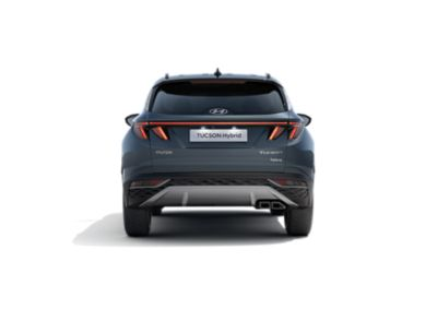 The all-new Hyundai Tucson Hybrid compact SUV pictured from the rear with its wide LED tail lamps.