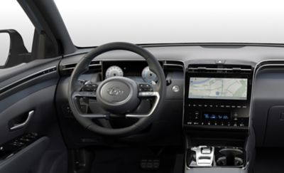 Interior view of the all-new Hyundai Tucson Hybrid compact SUV showing its steering wheel.