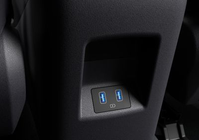 The centre console of the all-new Hyundai Tucson compact SUV showing the front and rear USB ports.