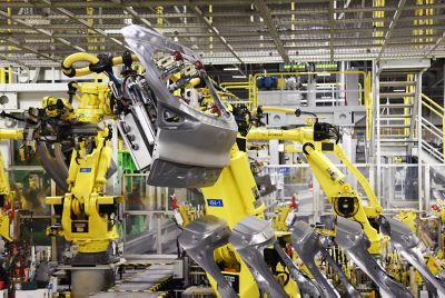 Robotic arms at work in a Hyundai manufacturing facility.