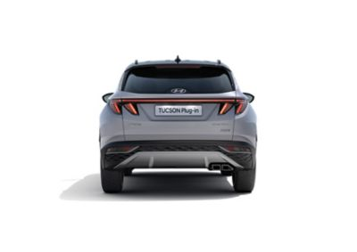 The all-new Hyundai TUCSON Plug-in Hybrid compact SUV pictured from the rear with its wide LED tail lamps.