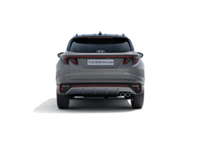 The all-new Hyundai TUCSON Hybrid N Line in shadow gray, seen from the rear.