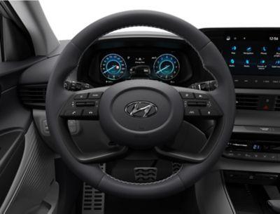 Il volante sportivo a quattro razze all'interno del Nuovo Urban SUV compatto Hyundai BAYON.