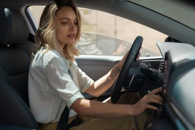 Picture of a woman in a Hyundai Ioniq Hybrid