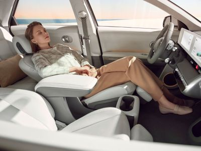 The fully electric and reclining front seats inside the Hyundai IONIQ 5 midsize CUV.