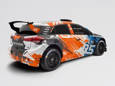 Photo of the i20 R5, shown from the rear and side, with visible spoiler and orange-blue painting.