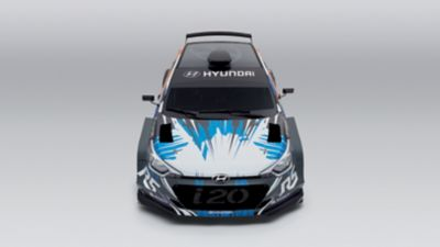 Photo of the i20 R5, shown from the top and front, with visible branded grille and white-blue painting.