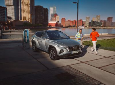 The all-new Hyundai TUCSON Plug-in Hybrid compact SUV parked near the ocean.
