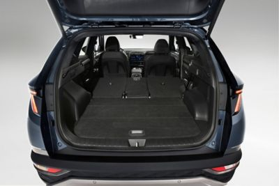 The opened trunk of the all-new Hyundai Tucson compact SUV with the backseats folded down.