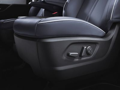 A close-up of the all-new STARIA's  driver seat's 8-way power adjustable position controls.